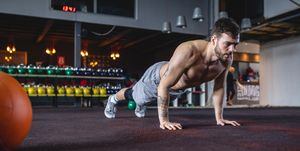 Handsome cross-fit athlete doing pushups