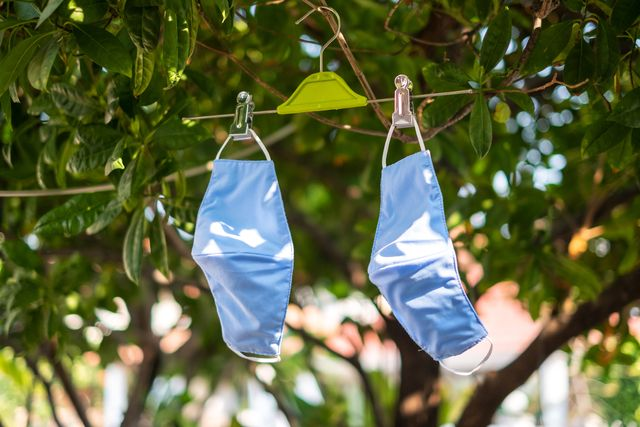 hanging and drying fabric face masks in the sun