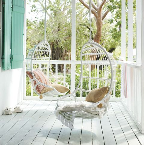 porch with white wicker swings