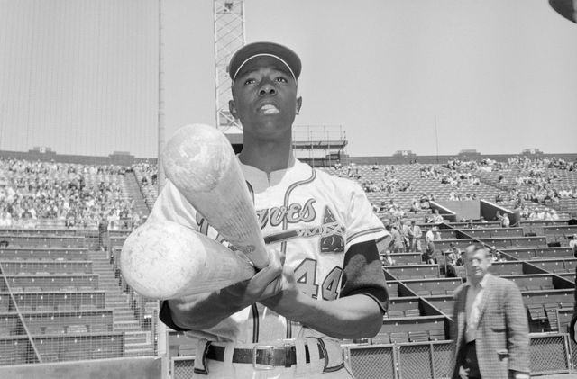 original caption milwaukee braves outfielder hank aaron doesn't really pack monstrous bats like these it simply looks that way to the opposition, as aaron sports his 484 batting average along with the giant bats hank and his teammates whipped the san fransisco giants here 4 2, 518