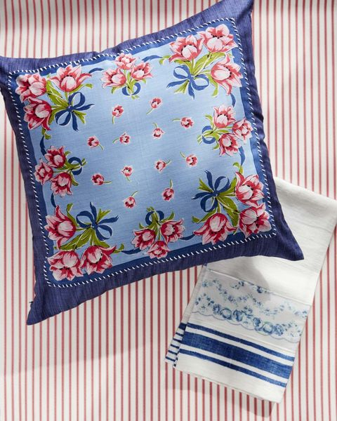 hand stitched tea towel and pillow with floral design