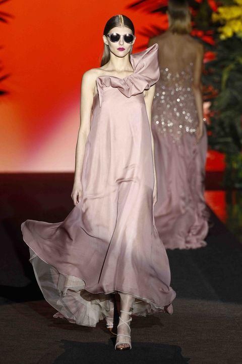 Fashion model, Fashion, Clothing, Haute couture, Fashion show, Runway, Dress, Shoulder, Fashion design, Pink,