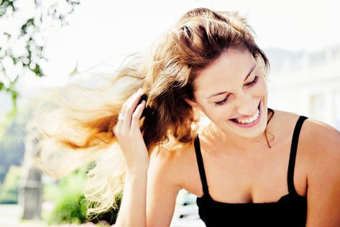happiness, natural laughing woman in summer park portrait