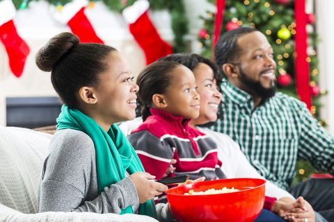 Happy African American family watch a Christmas movie