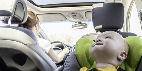 Happy Baby Boy Secure in Baby Car Seat