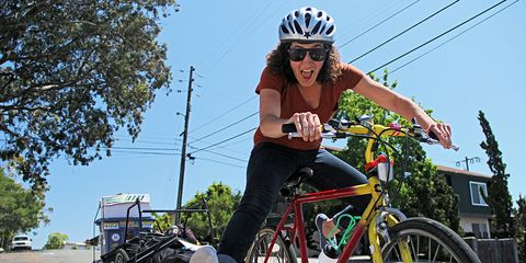 happy commuting cyclist