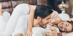 Happy couple in love having playful time together