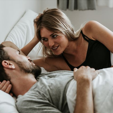 Romantic moment: Happy couple in love in the bed - Stock image