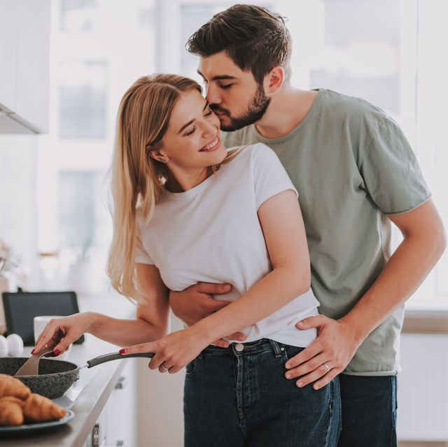 happy lovers cooking food and showing their feelings