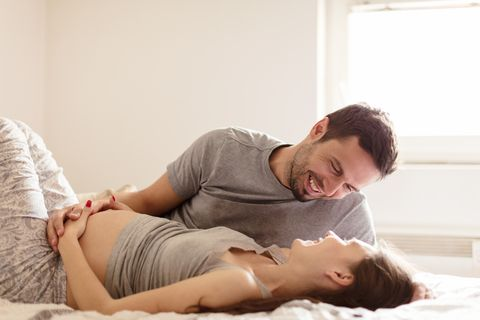 Happy man with pregnant woman