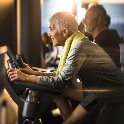 Happy mature woman feeling determined on exercising class in a gym.