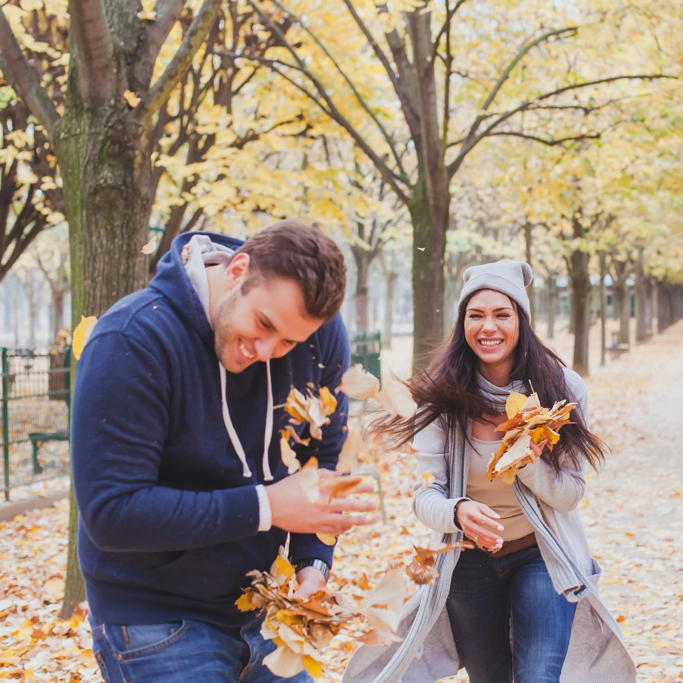 happy young couple playing in autumn park