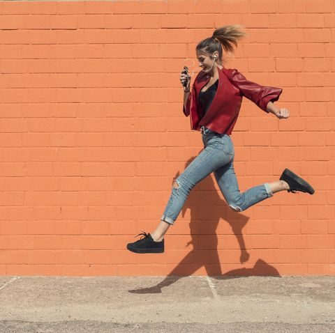happy young woman running to school