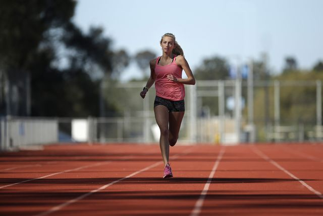 a female runner trains on a track on a sunny day in san diego, california san diego is one of the top places for runners to train in the united states because of its low precipitation and mild climate