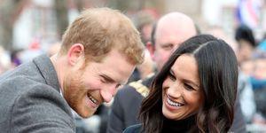 Een lachendeMeghan Markle en Prins Harry