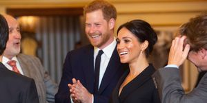 Harry and Meghan watching Hamilton