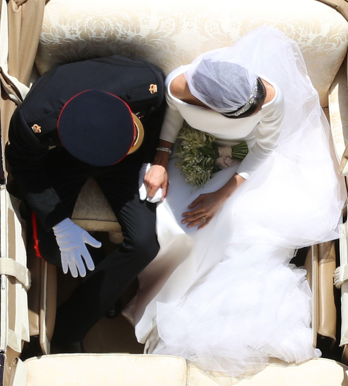 https://hips.hearstapps.com/hmg-prod.s3.amazonaws.com/images/harry-meghan-wedding-4-1526743515.jpg