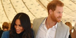 The sweet moment Prince Harry fixed Meghan's hair in the wind at her cookbook launch