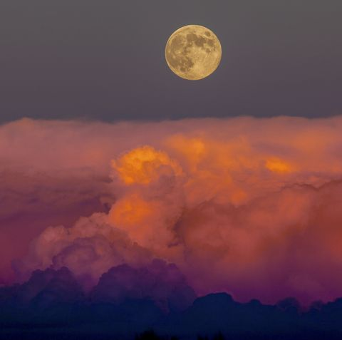 Harvest moon rising above storm clouds, western Colorado.