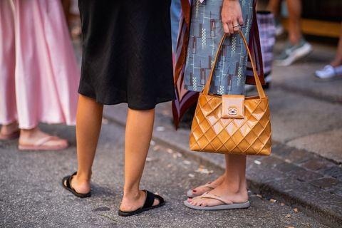 Brown, Human leg, Textile, Bag, Style, Tan, Pattern, Luggage and bags, Fashion, Street fashion,