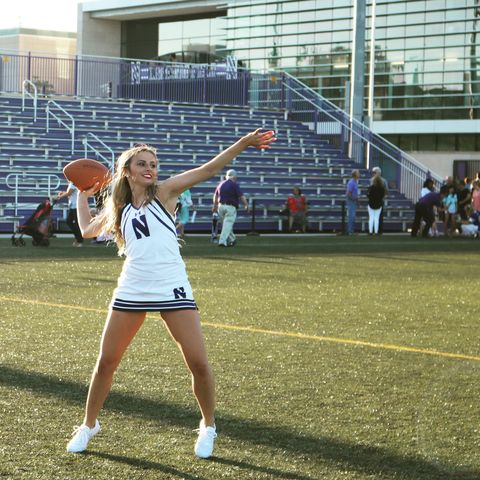 hayden richardson, here in her cheerleading outfit, throwing a football