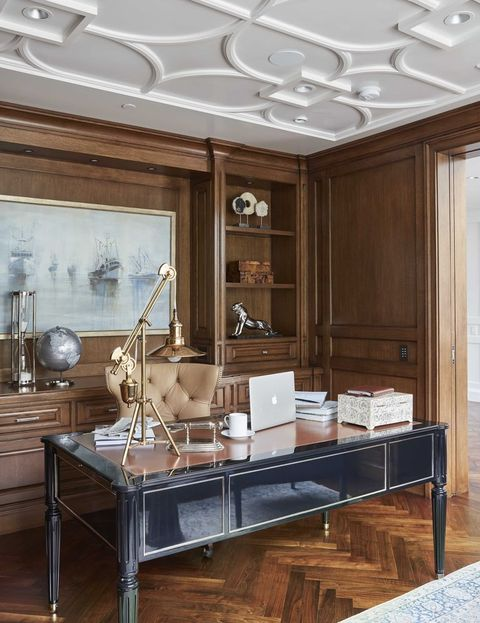 office with black office desk, wooden floor, wooden cabinets