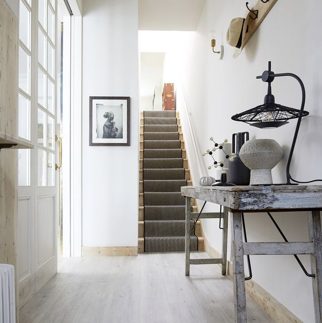 carpetright flooring – house beautiful, corinthian doric laminate and portobello wool carpet in magpie stripes
