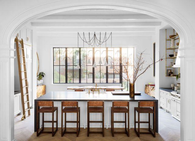white kitchen, wooden chairs