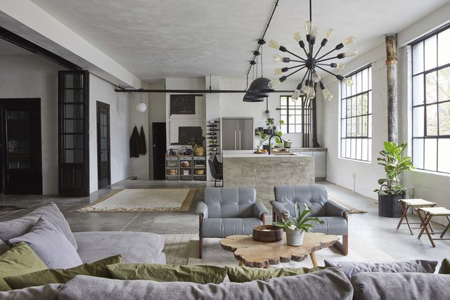 living room, gray chairs, concrete floors, wooden table