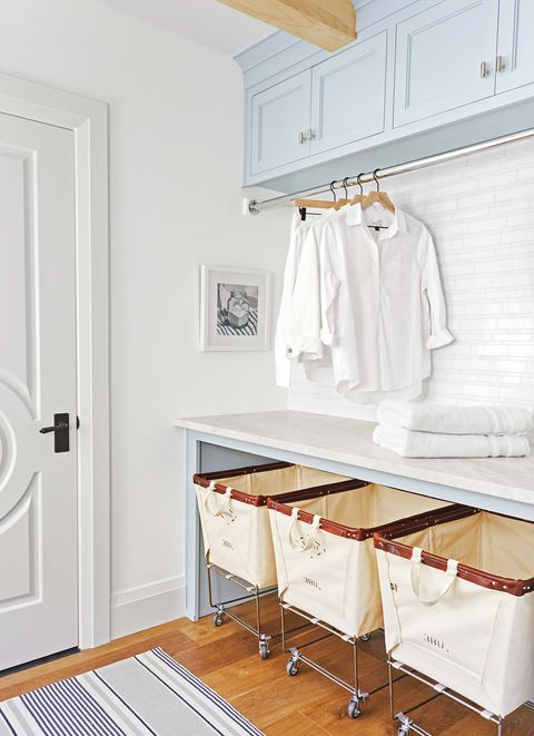 White, Room, Furniture, Property, Yellow, Clothes hanger, Interior design, Laundry room, Floor, Table,