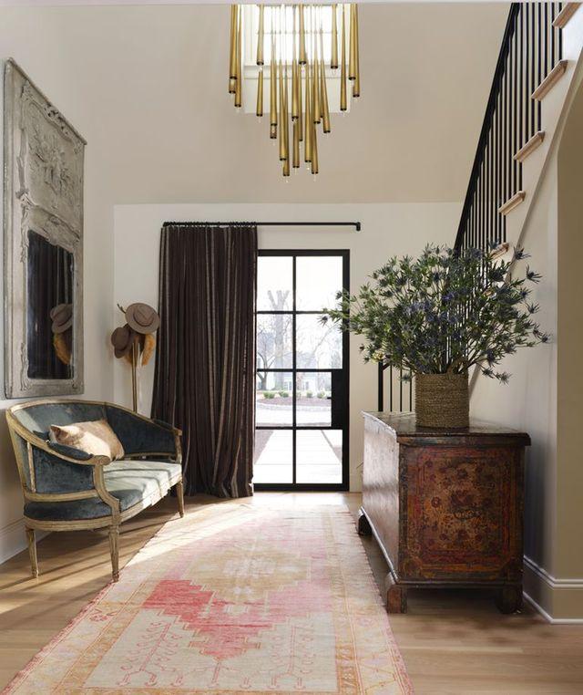 wellborn and wright door, elitis fabric, john richard chandelier, silver satin by benjamin moore paint, settee wall mirror, oushak rug, coatrack, spanish coffer