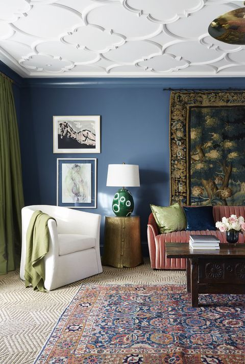 sitting room, blue painted wall, red couch, textured rug and carpet