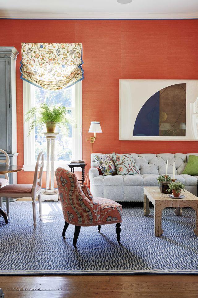 living room, orange wallpaper, white couch