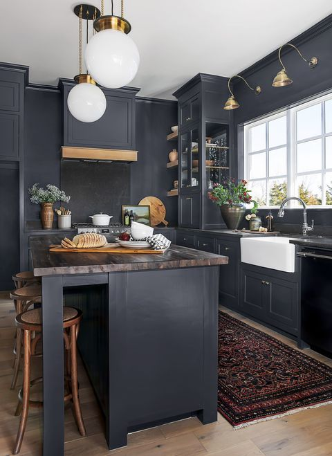 blue english style kitchen with patterned carpet