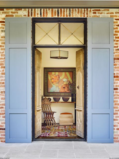 home with blue doors designed by meredith mcbrearty in fort worth