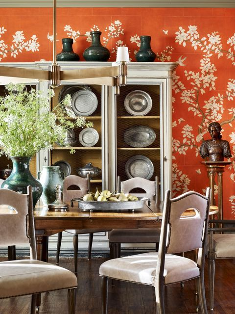 orange dining room designed by meredith mcbrearty in fort worth