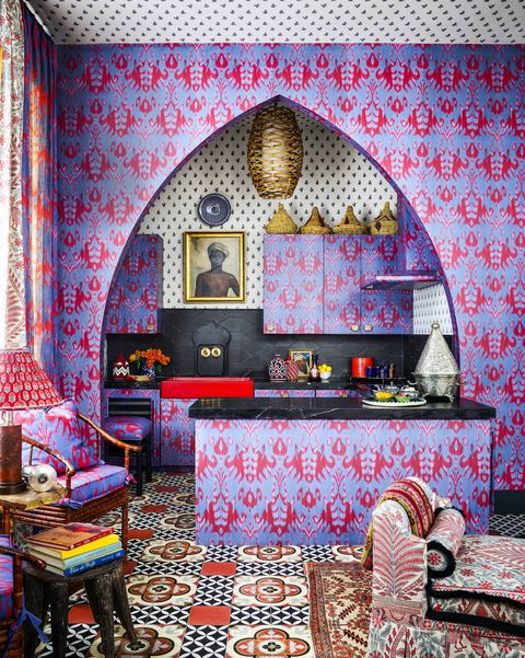 arched kichen with patterned wallpaper