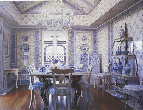 dining room, blue and white wall covering, vases, dining table set up with blue and white fine china and cutlery