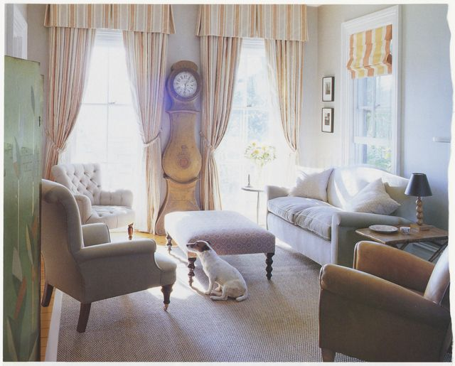 living room, white couch with foot ottoman, white and yellow stripped curtains