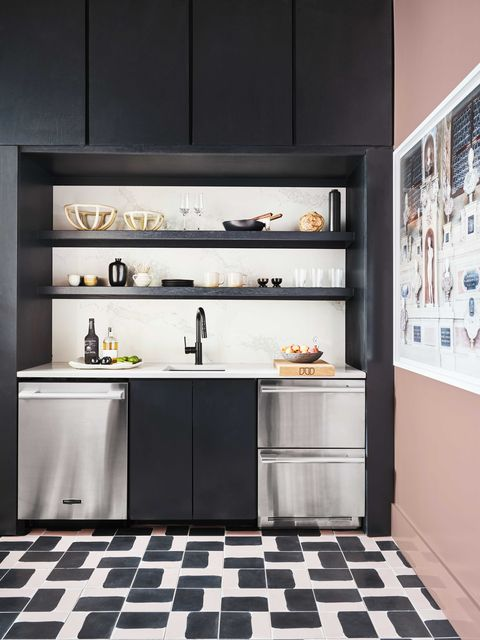 wet bar, pink walls, stainless steel appliances, black cabinets and black shelves