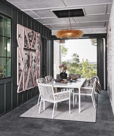 covered walkway, white table and chairs, outdoor wall art