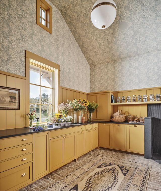 laundry room, yellow cabinets, flowers, wallpaper