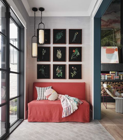 entryway, red couch, black floral wall art