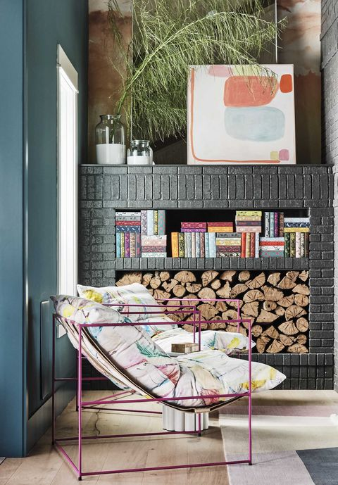 sitting area, wood stack, fireplace, colorful lounge chairs