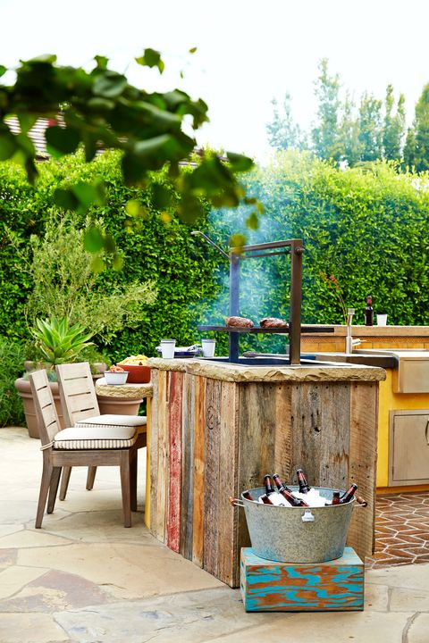 12 Outdoor Kitchen Design Ideas and Pictures - Al Fresco ... on ideas for roofing, ideas for kitchen remodels, ideas for tile, ideas for stucco, ideas for columns, ideas for mailboxes, ideas for patio furniture, ideas for pavers, ideas for fencing, ideas for mulch, ideas for doors, ideas for arbors, ideas for bars, ideas for firepits, ideas for railings, ideas for sidewalks, ideas for hardscaping, ideas for brick, ideas for water features, ideas for grills,