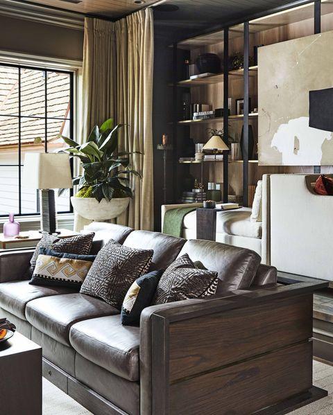Living room, Furniture, Room, Interior design, Property, Building, Home, Table, Shelf, House,
