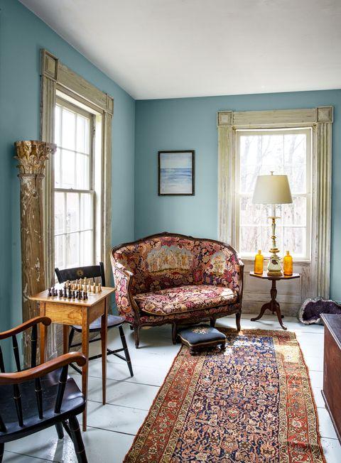 Room, Furniture, Living room, Interior design, Green, Blue, Property, Yellow, Building, Floor,