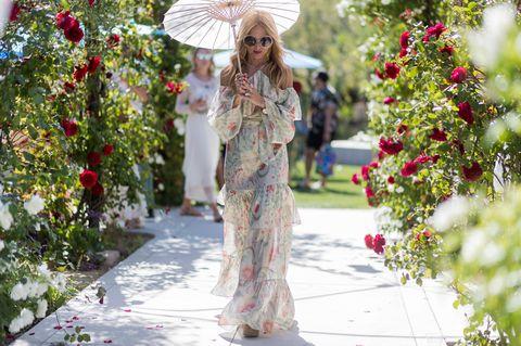 Hat, Petal, Sunglasses, Dress, Sun hat, Street fashion, Garden, Shrub, Sombrero, Camouflage,