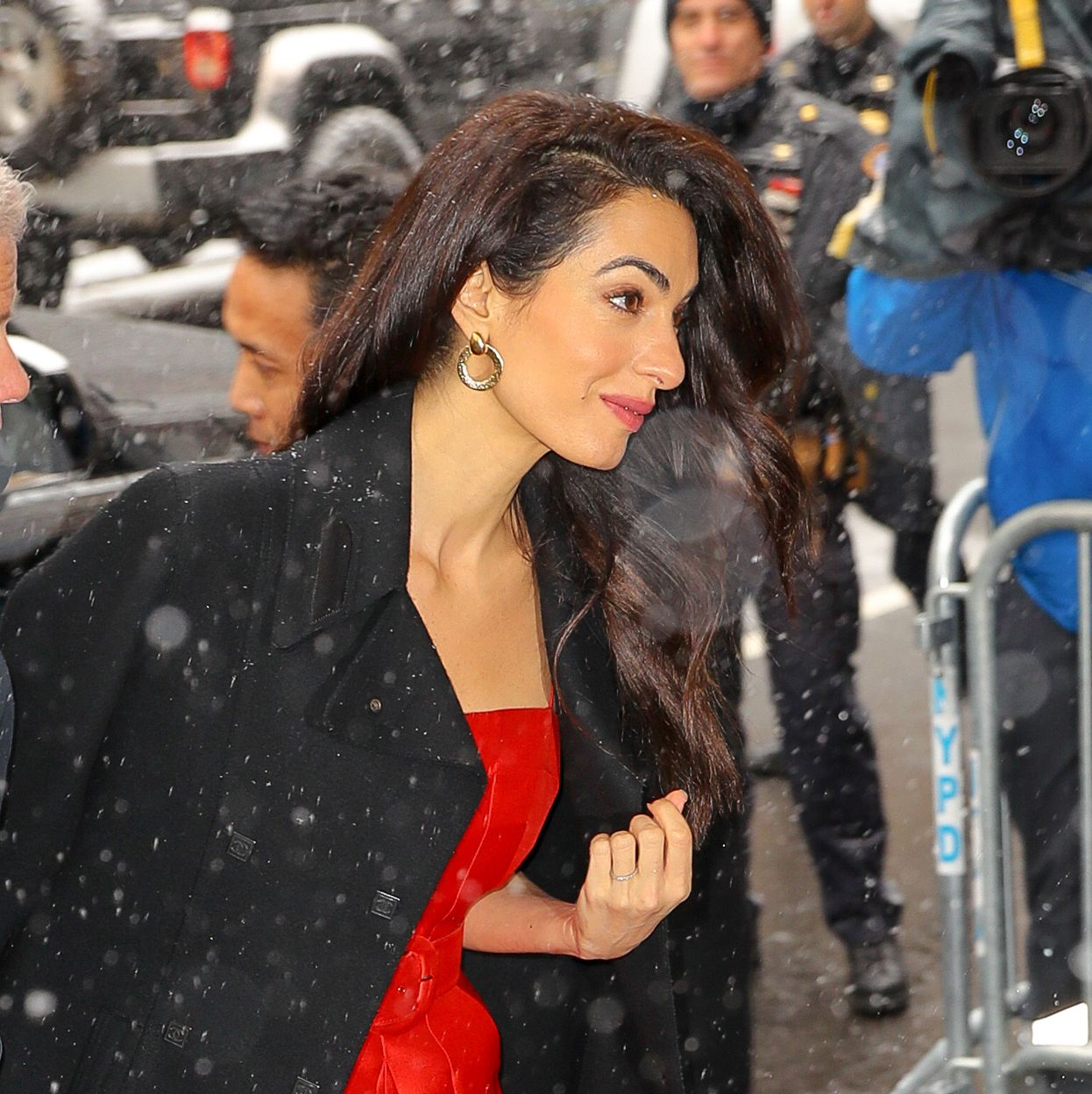 Amal Clooney Stuns in a Bright Red Jumpsuit at Meghan Markle's Baby Shower