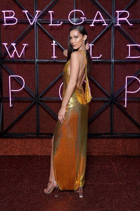 Formal wear, Dress, Fashion, Gown, Haute couture, Fashion design, Long hair, Flooring, Peach, Style,